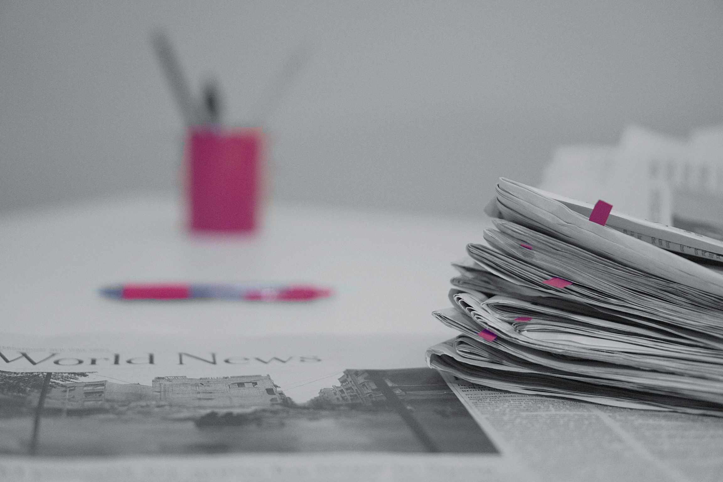 Close-Up Of Newspaper On Table