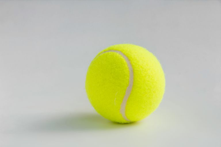 Close-Up Of Tennis Ball On White Background
