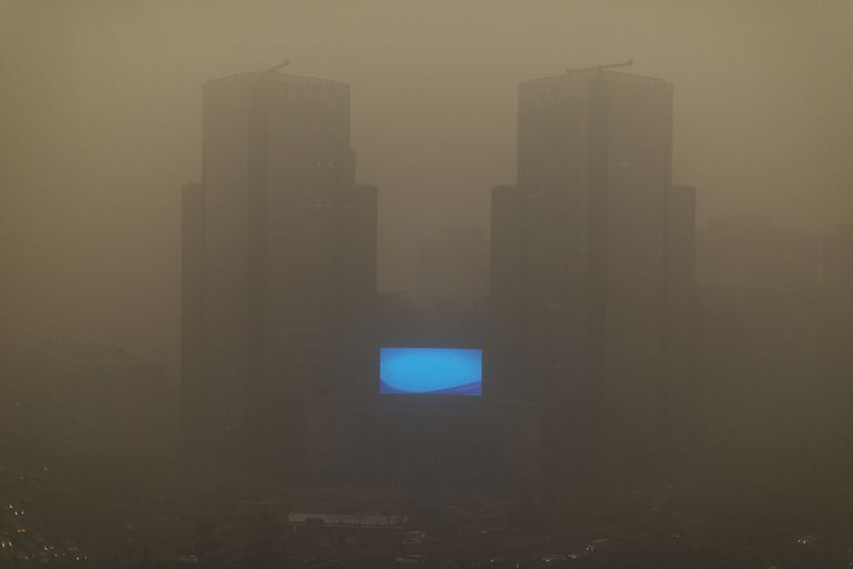This is an example of the type of air pollution known as smog. This photo shows Beijing in 2015. The word smog is a combination of smoke and fog.