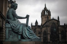 Statue of philosopher David Hume near St. Giles Cathedral on the Royal Mile in Edinburgh, Scotland.
