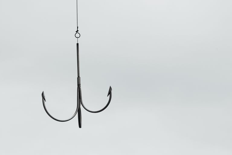 Close-Up Of Metallic Hook Against Clear Sky