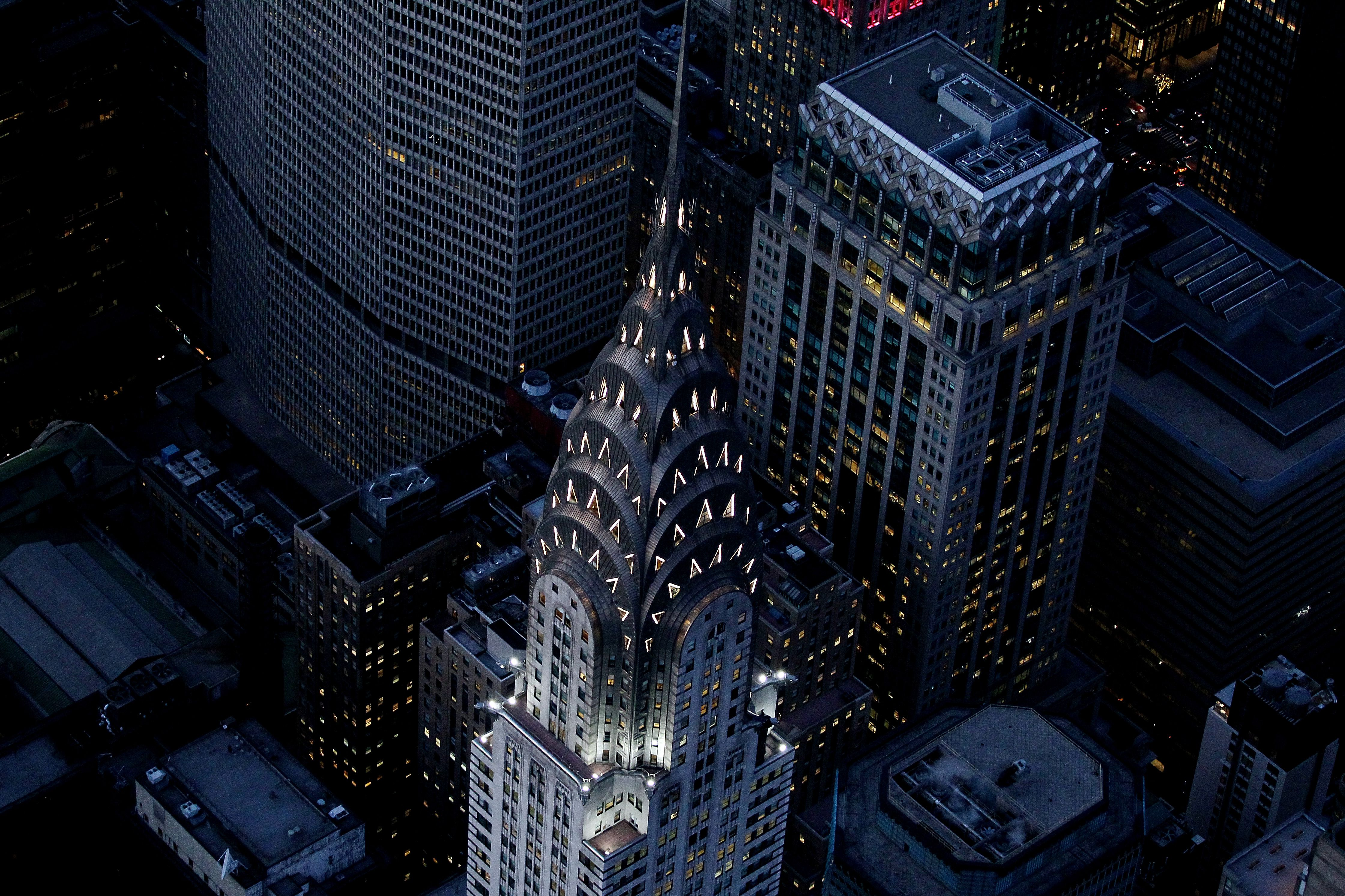 Night aerial view of the top of the Art Deco Chrysler Building in New York City has jazzy automobile ornaments