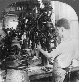 Matzeliger's Lasting Machine shaping shoes at a Lynn shoe factory.