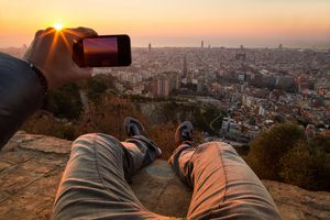 Man taking pictures of a Barcelona sunrise.