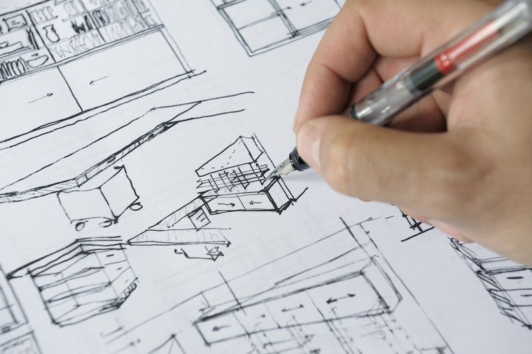 When you need a professional architect close up of hand with pen sketching a custom kitchen solutioingenieria Images