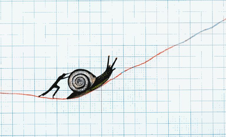 Man pushing snail up slowly ascending line on graph