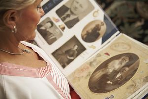 Woman looking at a family photo album