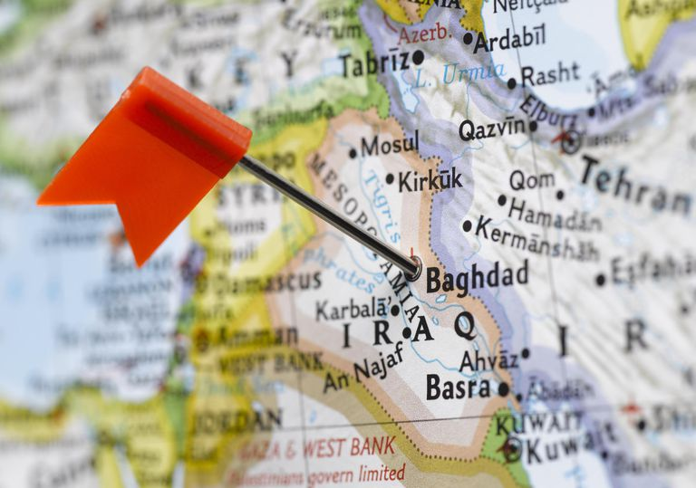 Map pin placed in Baghdad, Iraq on map, close-up