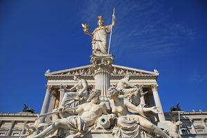 Athena fountain against blue sky.