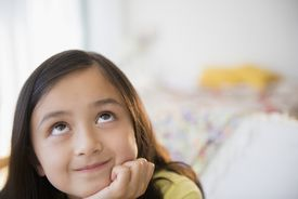 A young girl thinking