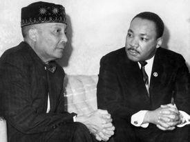 Martin L. King Seated with Elijah Muhammad.