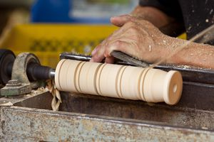 The most common origin of the Turner surname is one who worked with a lathe.