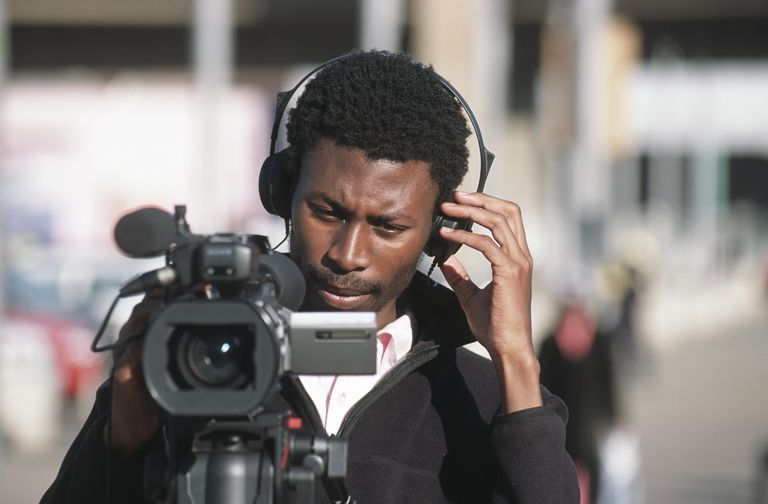 Man operating a video camera