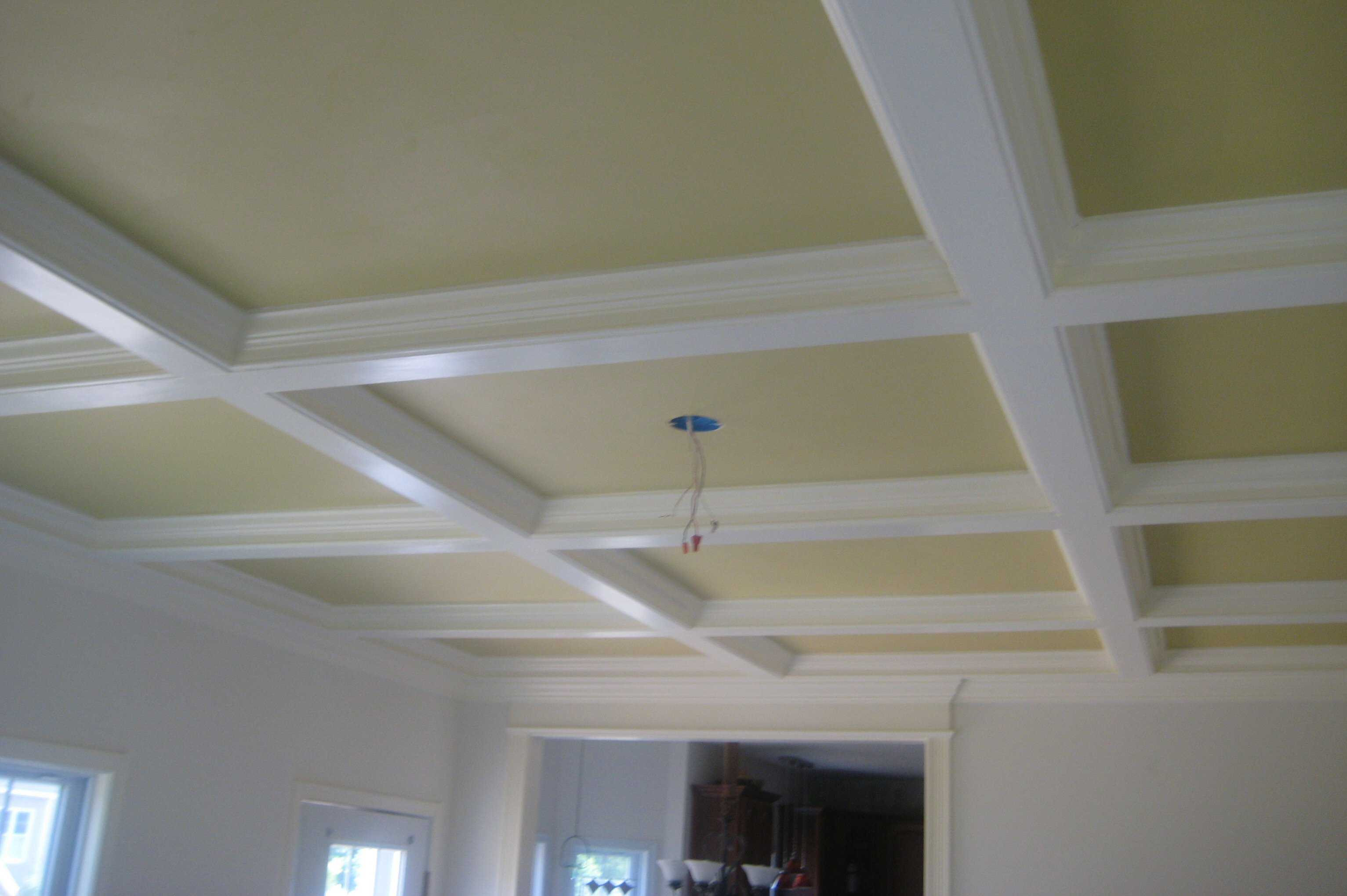 Coffered ceiling squared indentations made from white colored wood protrusions ceiling ready for