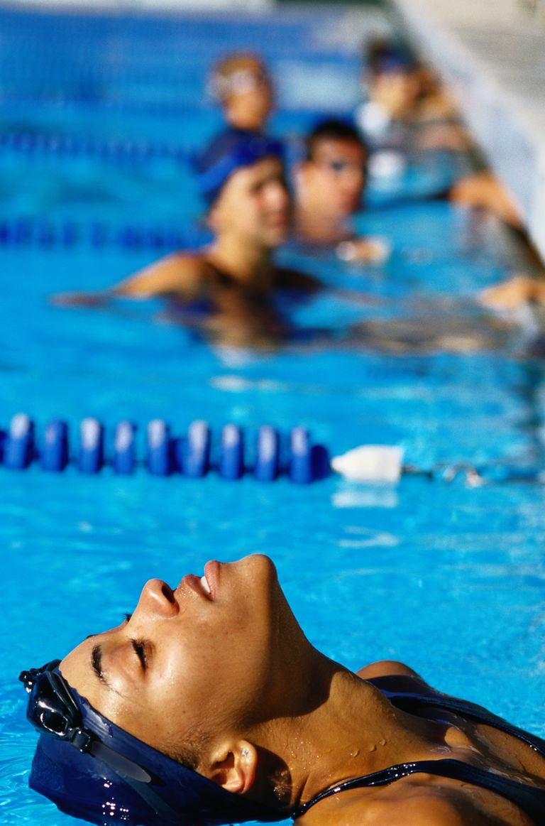 Swimmer Stretching in a Swimming Pool