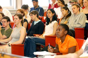 Students sitting in class looking toward the front of the room.