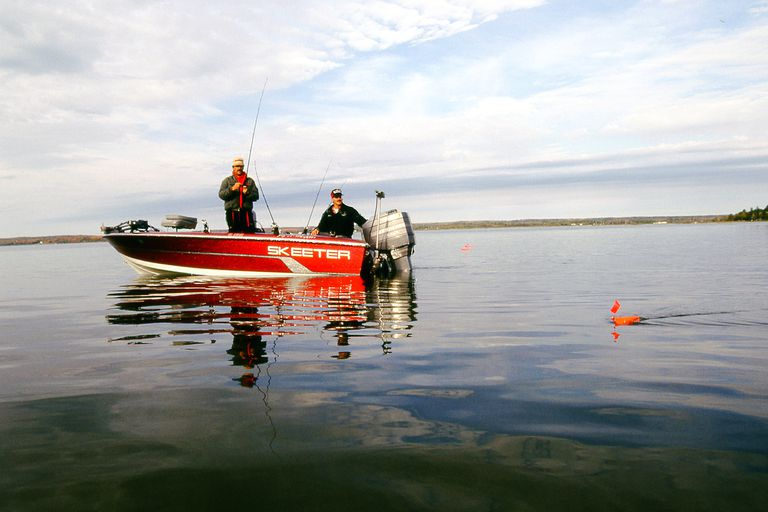 Two men in a boat trolling lures