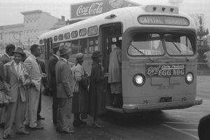 African Americans board an integrated bus following the successful end of a 381-day bus boycott in Montgomery, Alabama.