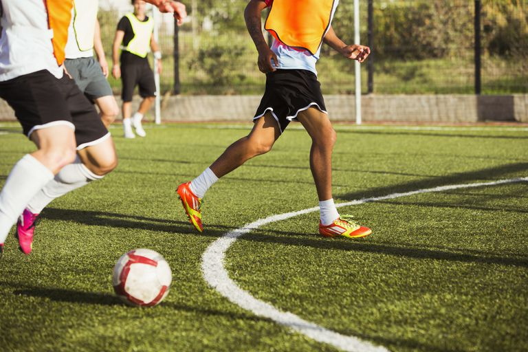 Soccer players training on field
