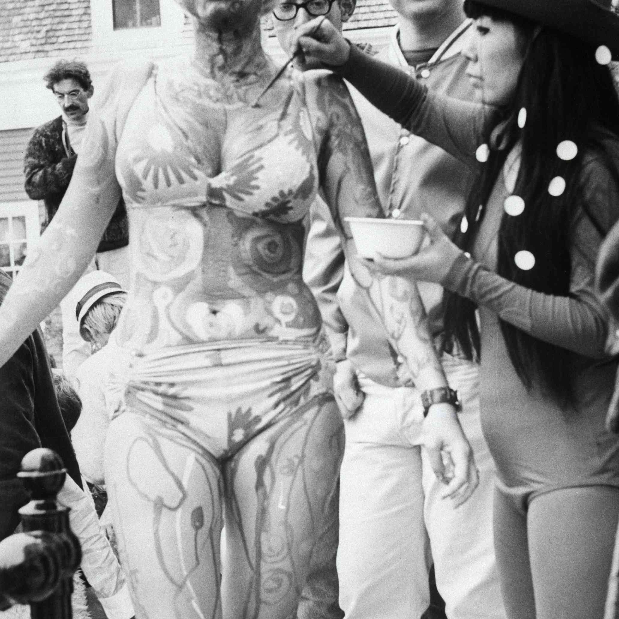 Hippie Having Body Painted