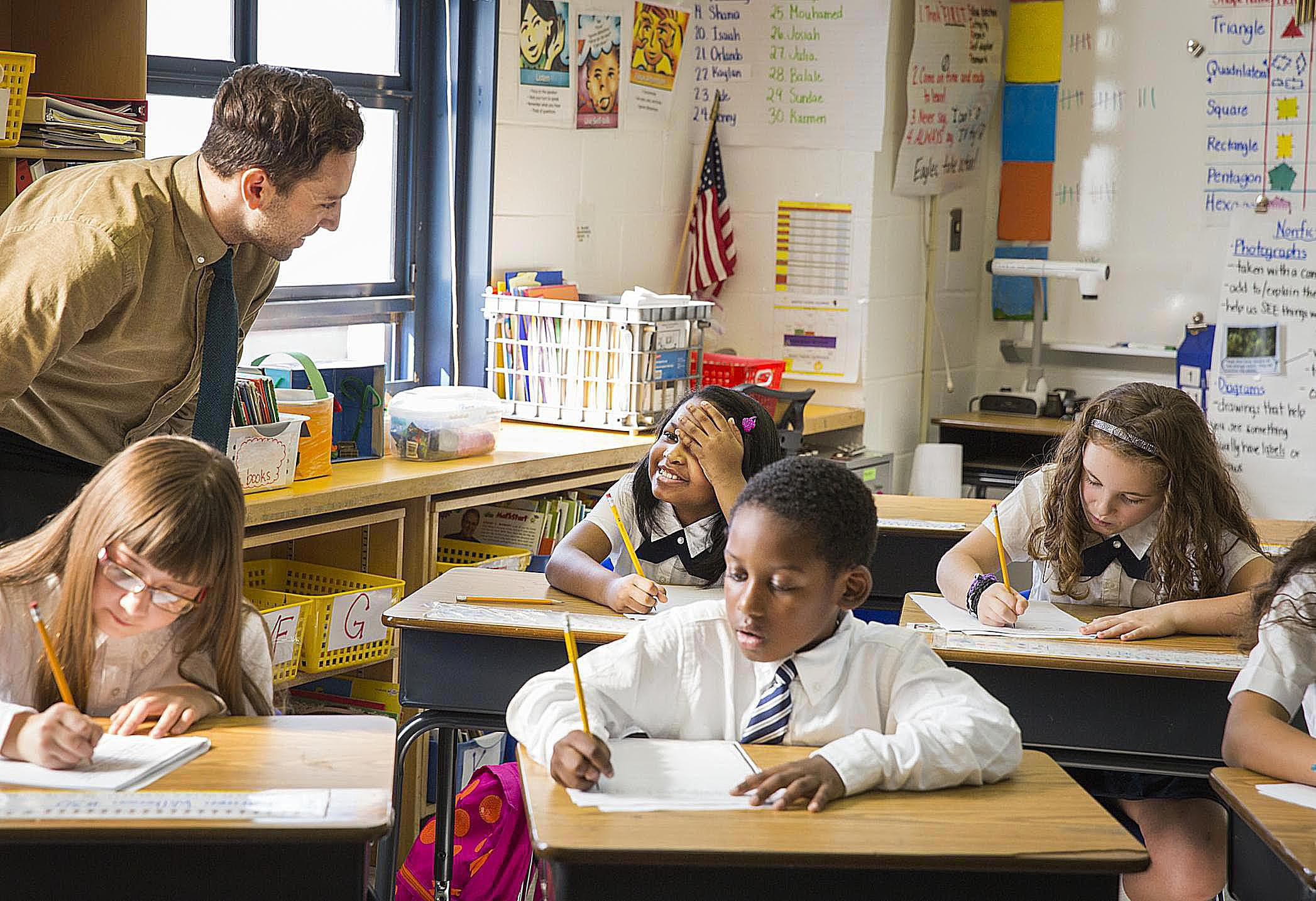 Teacher Helping Students with Writing Assignment