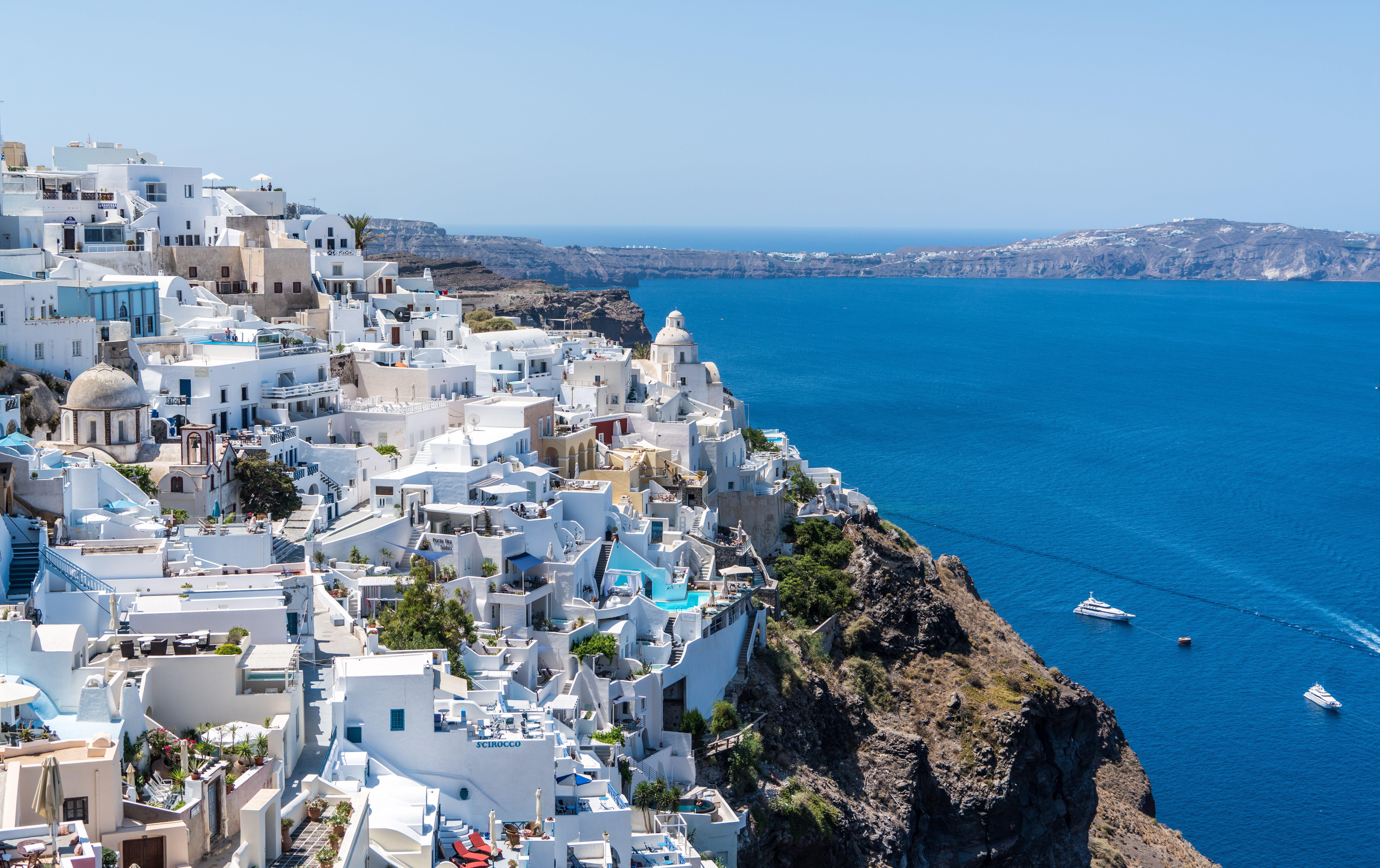 Greek coastline with buildings and water.