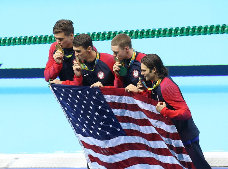 Michael Phelps, Ryan Murphy, Cody Miller of USA celebrate their gold medal in the Men's 4 x 100m Medley Relay on day 8 of the Rio 2016 Olympic Games