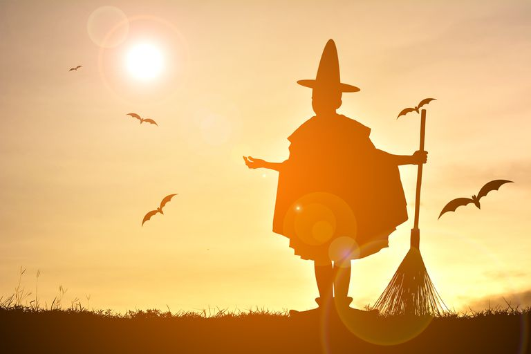 Witch With Broom at Sunset