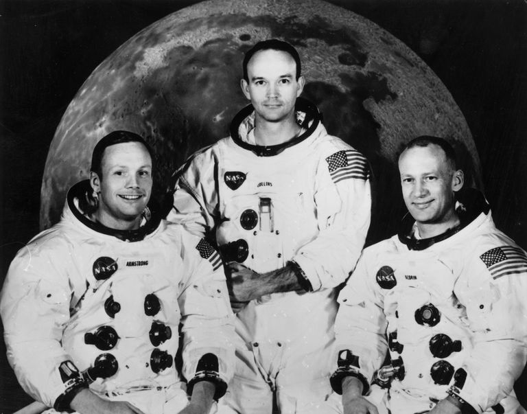 The Apollo 11 astronauts in official NASA portrait, black and white photograph.