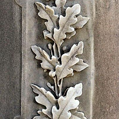 Oak trees, oak leaves and acorns are commonly seen cemetery icons