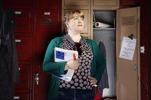 Female In Front Of Open Locker