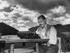Ernest Hemingway at his typewriter