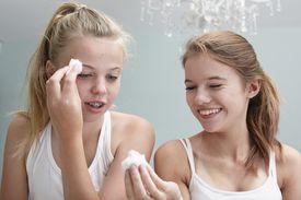 Teen girls applying ammonia with cotton balls