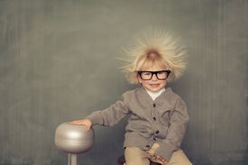 child with hair standing up from static electricity