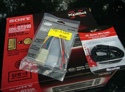 Car stereo, wiring kit and iPod cable.