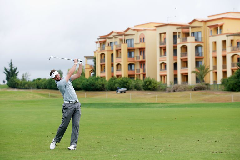 Golfer Scott Jamieson strikes the ball during the Portugal Masters golf tournament