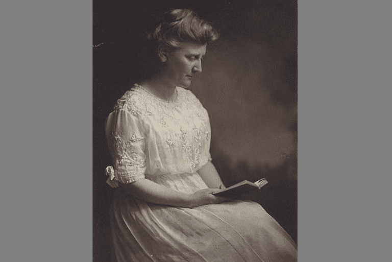 Photograph of Mary White Ovington, reading