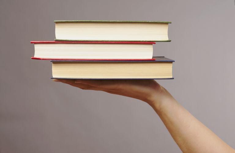 Hand-holding-textbooks