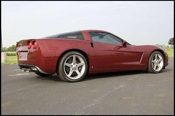 Corvette C6 parked on road.