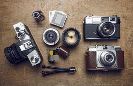 Photographic equipment, cameras, slides, lenses, rolls of film