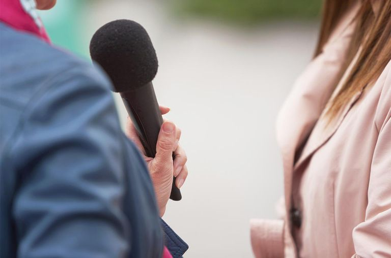 journalist interviewing woman
