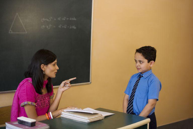 teacher scolding student