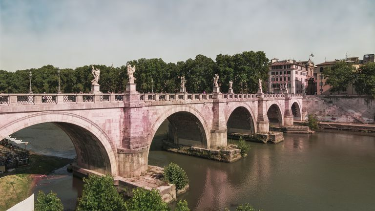 Ponte Sant'Angelo bridge spanning the Tiber River.