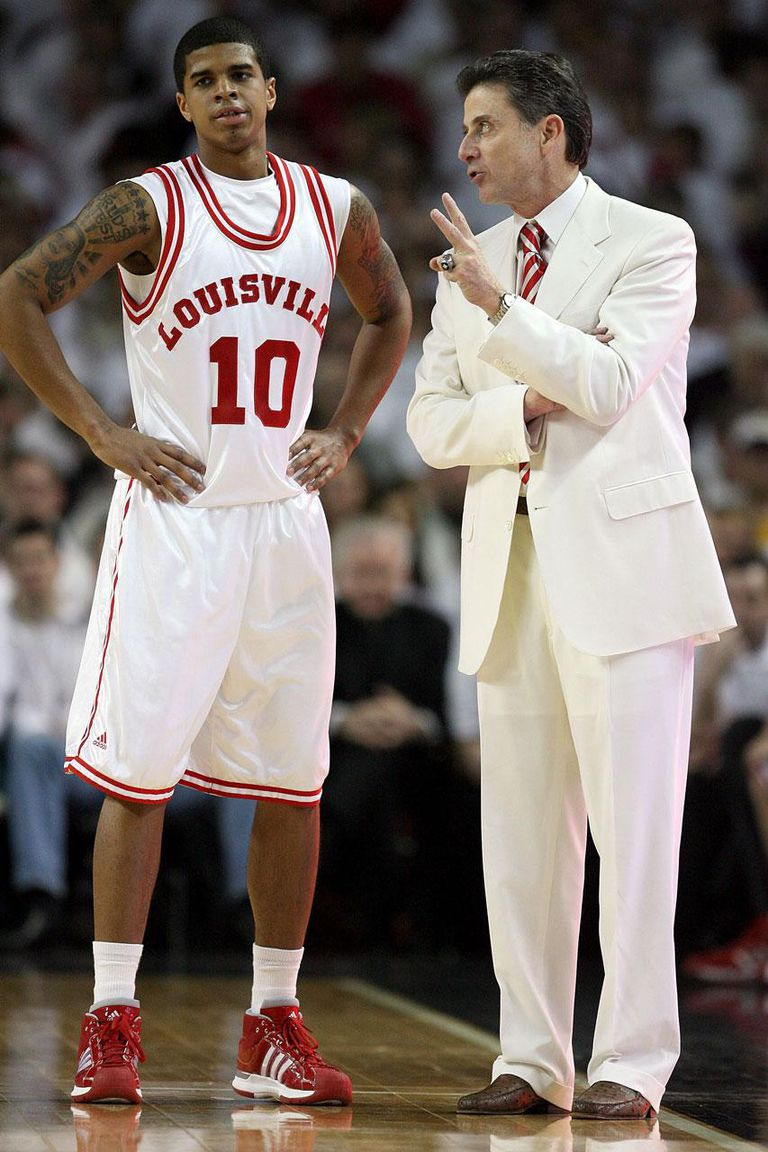 LOUISVILLE, KY - MARCH 01: Rick Pitino the Head Coach of the Louisville Cardinals gives instructions to Edgar Sosa #10 during the Big East Conference game against the Marquette Golden Eagles at Freedom Hall on March 1, 2009 in Louisville, Kentucky.