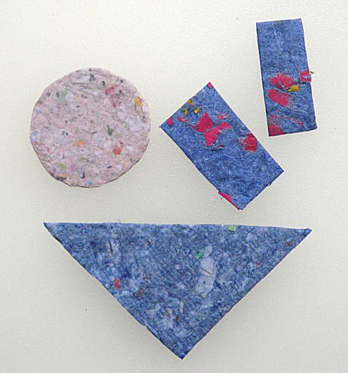 These are shapes made from handmade paper which was crafted by recycling old paper.