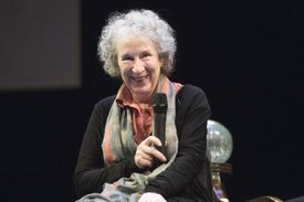 Margaret Atwood holding a microphone onstage