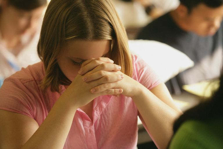Teen Praying in Class