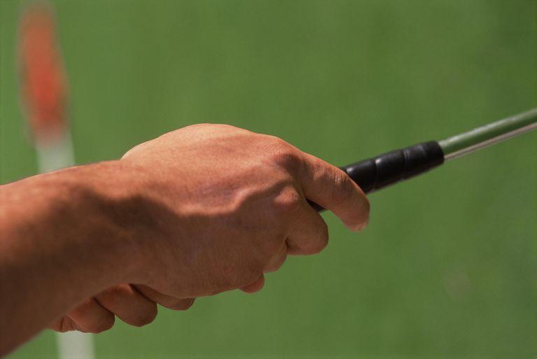 Golfer gripping club