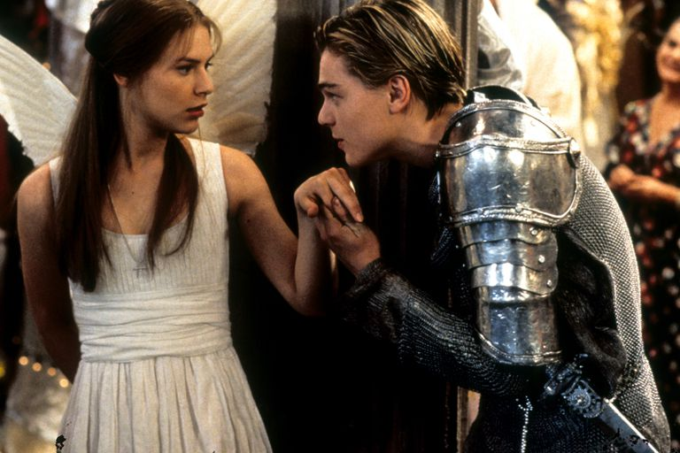 Claire Danes as Juliet is surprised by Leonardo DiCaprio's Romeo kissing her hand