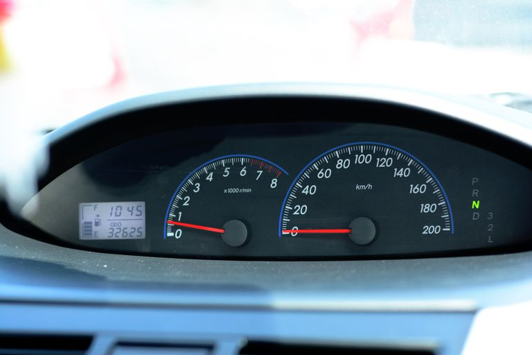 Gages in car showing mileage